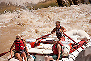 Rafters negotiate Skull Rapid during a trip down the Colorado River in Westwater Canyon Utah.