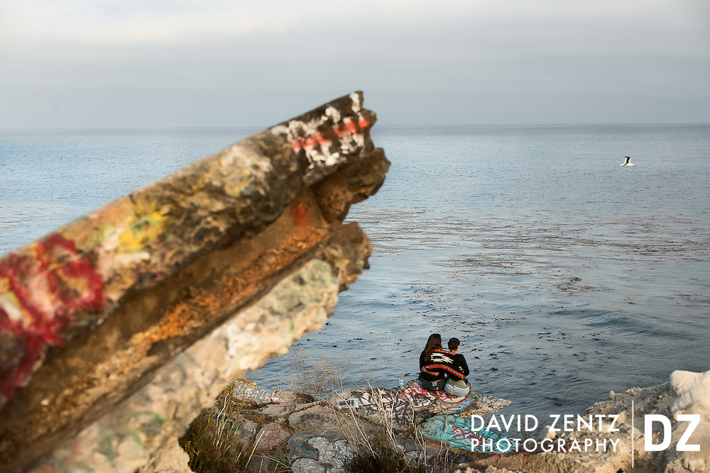 A couple looks out over the Pacific from a perch in The Sunken City, San Pedro, Calif.