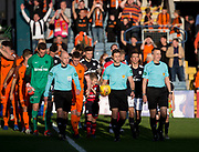 August 9th 2017, Dens Park, Dundee, Scotland; Scottish League Cup Second Round; Dundee versus Dundee United; Dundee United captain Thomas Scobbie and Dundee captain Cammy Kerr lead the teams out for the derby