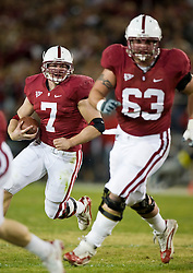 November 28, 2009; Stanford, CA, USA; Stanford Cardinal running back Toby Gerhart (7) rushes behind tackle Chris Marinelli (63) during the first quarter against the Notre Dame Fighting Irish at Stanford Stadium.