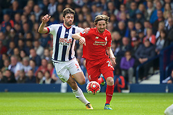 WEST BROMWICH, ENGLAND - Sunday, May 15, 2016: Liverpool's Joe Allen in action against West Bromwich Albion's Claudio Yacob during the final Premier League match of the season at the Hawthorns. (Pic by David Rawcliffe/Propaganda)