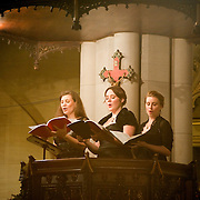 January 2, 2011 - Manhattan, NY : Musicians from the Green Mountain Project took part in a celebration of the 401st anniversary of Claudio Monteverdi's Vespers of 1610 at the Church of St. Mary the Virgin in Midtown Manhattan on Sunday night.           Sopranos Jolle Greenleaf, left, and Molly Quinn, center, and alto Virginia Warnken perform from the pulpit.  //Assignment ID: 10105591A // Credit: Karsten Moran for the New York Times //