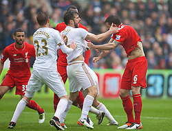 SWANSEA, WALES - Sunday, May 1, 2016: Liverpool's Dejan Lovren clashes with Swansea City's Jordi Amat during the Premier League match at the Liberty Stadium. (Pic by David Rawcliffe/Propaganda)