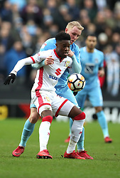 Milton Keynes Dons' Ike Ugbo and Coventry City's Jack Grimmer battle for the ball during the Emirates FA Cup  Fourth Round match at  Stadium MK Milton Keynes.