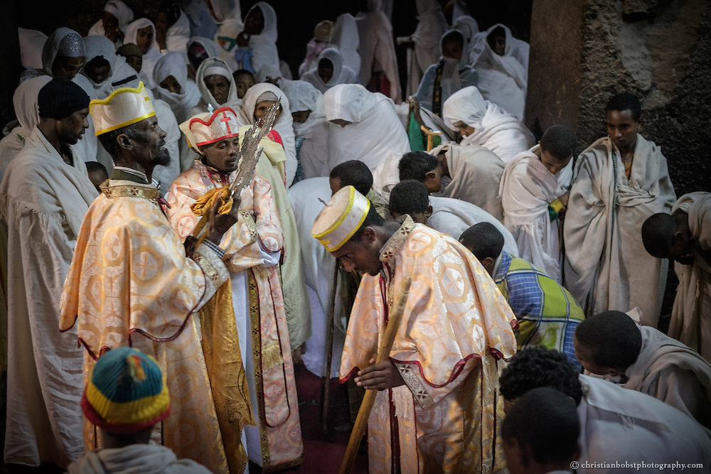 Christian orthodox ceremonies at the rock-hewn churches in Lalibela, Ethiopia during Mescel, one of the highets days of the Ethiopien orthodox church. The festival is known as Feast of the Exaltation of the Holy Cross in other Orthodox, Catholic or Protestant churches. With its 900-year-old churches carved from rock, the Ethiopian town of Lalibela attracts tens of thousands of pilgrims from all over Ethiopia each year.