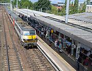 British Rail Class 90 25kV Bo-Bo electric locomotive 90011 train, Ipswich station, England, UK