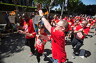 Torch bearers carrying the torch arrive in downtown Los Angeles, where a cauldron will be lit two weeks ahead of the Special Olympics World Games' opening ceremony, on Tuesday, July 10, 2015. The Special Olympics Flame of Hope, which has been carried in a torch relay across the United States by thousands of runners on three routes, arrived in downtown Los Angeles,  The Special Olympics Flame of Hope officially arrived in Los Angeles after having traveled 46 days and over 20,500 miles as part of the first-ever Special Olympics Unified Relay Across America. The Unified Relay began its journey as three simultaneous routes in Augusta, Maine, Washington, D.C. and Miami, Florida on 26 May and has traveled west, visiting all 50 states, to deliver the Flame of Hope to Los Angeles in anticipation of the 2015 Special Olympics World Games starting on 25 July.(Photo by Ringo Chiu/PHOTOFORMULA.com)