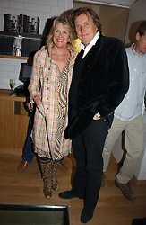 THEO & LOUISE FENNELL at the opening party for Tom's Kitchen - the restaurant of Tom Aikens at 27 Cale Street, London SW3 on 1st November 2006.<br />