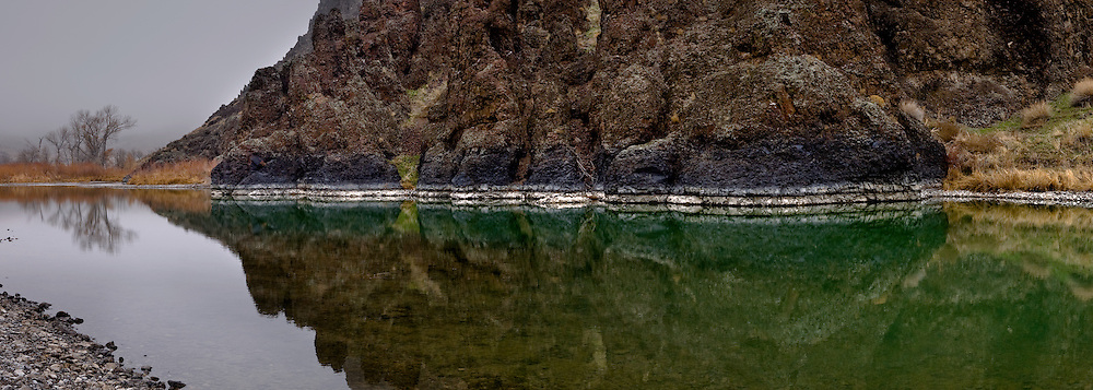 Higher water stains the basalt of the Owyhee River with sediments from early spring flows.