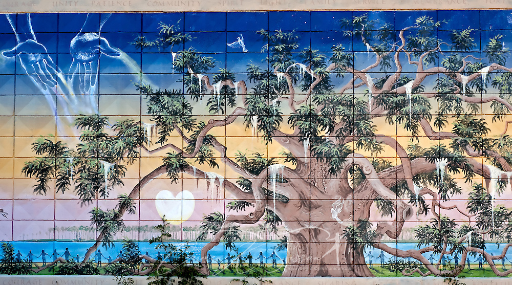 "An intricate painting of tree graces a cinderblock wall May 8, 2011 at Camp Victor in Ocean Springs. Ocean Springs, known as the ""City of Discovery,"" features whimsical street art throughout the downtown area. Much of the artwork tells the story of the town's history, from its founding by the French in 1699 to the devastation and recovery after Hurricane Katrina. (Photo by Carmen K. Sisson/Cloudybright)"