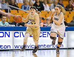 Lincoln guard Gracy Lamm (24) drives up the floor against North Marion during a first round game at the Charleston Civic Center.