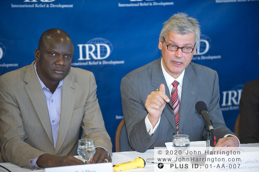 "Enrico Carisch, former UN sanctions monitor in Sudan, speaks during a panel discussion featuring radio journalist Kojo Nnamdi as moderator, John Dau, former Southern Sudanese ""Lost Boy"" and human rights activist, Andrea Freeman, a Program Analyst with USAID's Office of Sudan Programs, and Richard Owens, the Director of Community Stabilization at IRD at the National Press Club in Arlington, VA on December 9th, 2010. The panel discussed the impact of the possible secession of Southern Sudan from Sudan on the future of the African region."