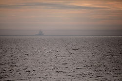 USA ALASKA CHUKCHI SEA 26JUL12 - A Shell-chartered icebreaker is seen in the distancenear the pack ice egde in the Chukchi Sea near a proposed Shell drill site north of Point Hope, Alaska.....Photo by Jiri Rezac / Greenpeace....© Jiri Rezac / Greenpeace