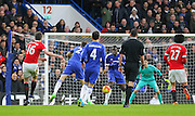 Michael Carrick shoots at goal during the Barclays Premier League match between Chelsea and Manchester United at Stamford Bridge, London, England on 7 February 2016. Photo by Phil Duncan.