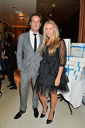 COLLETTE DINNIGAN and BRADLEY COCKS at a dinner to celebrate the publication of Obsessive Creative by Collette Dinnigan hosted by Charlotte Stockdale and Marc Newson held at Mr Chow, Knightsbridge, London on 9th February 2015.