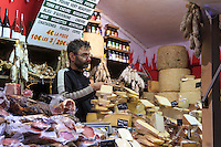 A meat and cheese stall on the Champs Elysees in Paris, France