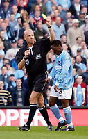 Photo. Jed Wee.<br /> Manchester City v Bolton Wanderers, FA Barclaycard Premiership, City of Manchester Stadium, Manchester. 18/10/03.<br /> Referee Steve Bennett shows Shaun Wright-Phillips the yellow card after his over zealous goal celebration.