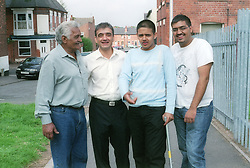 Three generations of men from a family,