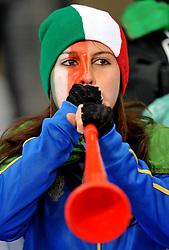 Football - soccer: FIFA World Cup South Africa 2010, Italy (ITA) - Paraguay (PRY), UNA TIFOSA ITALIANO SOFFIA NELLA VUVUZELAS LA TIPICA TROMBETTA