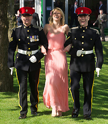 LIVERPOOL, ENGLAND, Thursday, April 7, 2011: Sophie from Liverpool is escorted by two soliders during Ladies' Day on Day Two of the Aintree Grand National Festival at Aintree Racecourse. (Photo by David Rawcliffe/Propaganda)