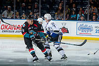 KELOWNA, CANADA - OCTOBER 4: Carsen Twarynski #18 of the Kelowna Rockets checks Scott Walford #7 of the Victoria Royals on October 4, 2017 at Prospera Place in Kelowna, British Columbia, Canada.  (Photo by Marissa Baecker/Shoot the Breeze)  *** Local Caption ***