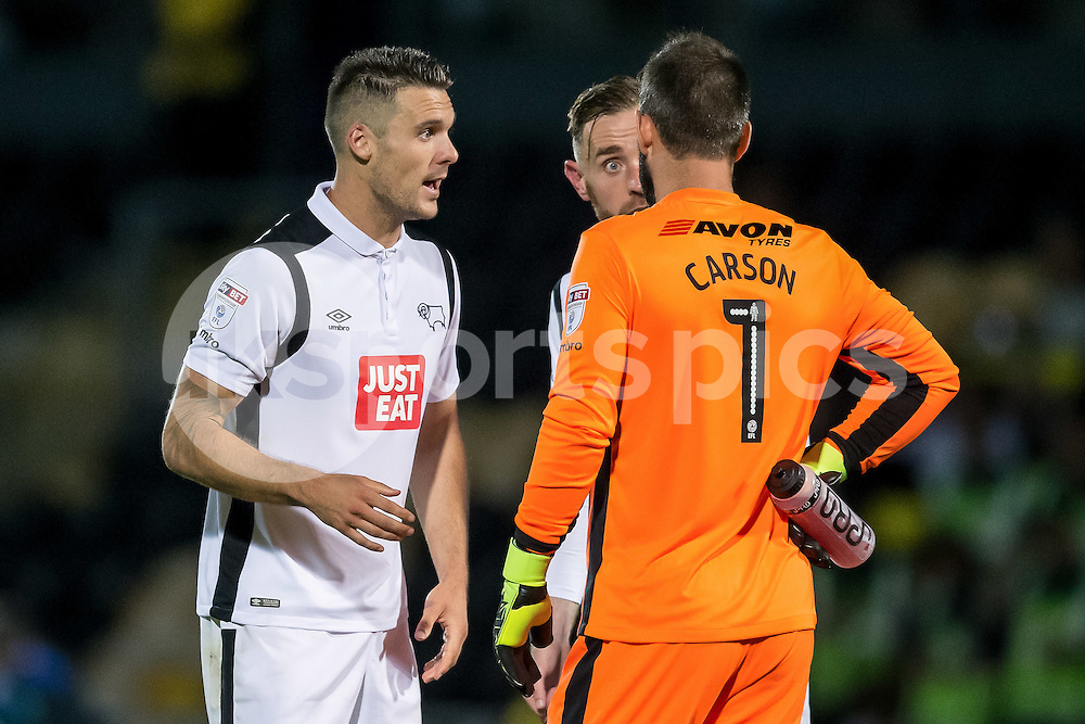 Jason Shackell Richard Keogh and Scott Carson of Derby County have a discussion before the start of the second half during the EFL Sky Bet Championship match between Burton Albion and Derby County at the Pirelli Stadium, Burton upon Trent, England on 26 August 2016. Photo by James Williamson.
