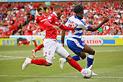 Reading defender Tyler Blackett (24) is pushed off the ball by Nottingham Forest forward Lewis Grabban (7) during the EFL Sky Bet Championship match between Nottingham Forest and Reading at the City Ground, Nottingham, England on 11 August 2018.