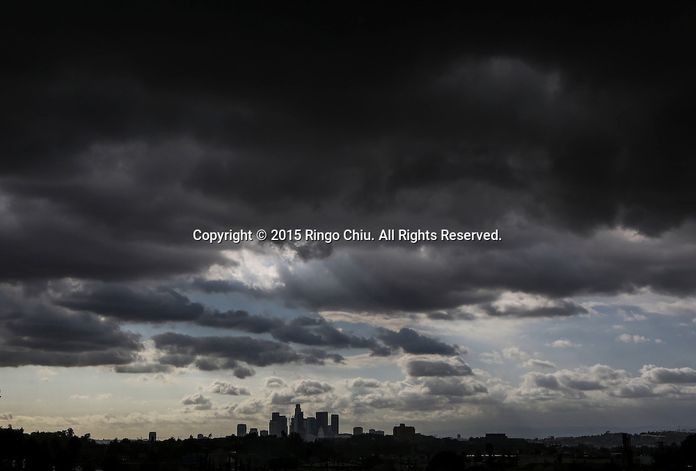 Storm clouds move over the downtown Los Angeles skyline on Monday, October 5, 2015. A storm system slowly moving out of the Southland dumped heavy rain in the San Gabriel Valley, flooding some streets in Temple City.(Photo by Ringo Chiu/PHOTOFORMULA.com)