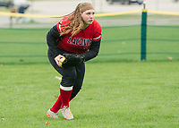 Laconia's Jera Kirk makes the out in left field during NHIAA Divison III softball Tuesday afternoon at Opechee Park.  (Karen Bobotas/for the Laconia Daily Sun)