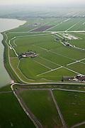 Nederland, Noord-Holland, Gemeente Zeevang, 28-04-2010; Polder de OosterKoog, buitendijks land van de Zuiderzee, in de voorgrond. Op het tweede plan Polder de Etersheimerbraak. Deze laatste  polder is een voormalige 'braak' (dijkdoorbraak) die in 1632 bedijkt is (en vervolgens drooggemaakt). Tijdens de watersnood van 1916 stond het water aan de kruin van de Zeevangszeedijk (Zuiderzee- of IJsselmeerdijk). Om de dijk op te hogen - met klei, zijn in 1917 in de Etersheimerbraakpolder kleiputten gegraven (het gedeelte tussen de boerderijen)..Foreground polder outside the seawall, behind it the Polder Etersheimerbraak. This polder is a former 'breach' (levee failure) that was diked in 1632 (and subsequently dried). During the flood of 1916, the water stood at the top of the Zeevang seawall. To raise the top of the seawall, clay was needed and in 1917 clay pits were dug in the Etersheimerbraakpolder (the part between the farms)..luchtfoto (toeslag), aerial photo (additional fee required).foto/photo Siebe Swart