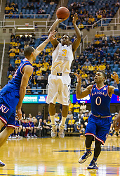 West Virginia Mountaineers guard Juwan Staten (3) shoots a jumper at the foul line against the Kansas Jayhawks during the second half at the WVU Coliseum.