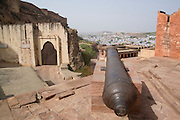 India, Rajasthan, Jodhpur, Mehrangarh fort a cannon on the walls surrounding the fort
