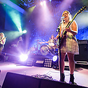 WASHINGTON, DC - February 24, 2015 - Carrie Brownstein, Janet Weiss and Corin Tucker of Sleater-Kinney perform during the first of two sold-out shows at the 9:30 Club in Washington, D.C. The band, on hiatus since 2006, reunited late in 2014 and recently released No Cities to Love, their first album in almost 10 years. (Photo by Kyle Gustafson / For The Washington Post)