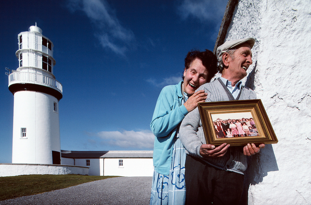 Lighthouse keeper Larry and Pauline Butler at Galley Head Lighthouse, Ireland.