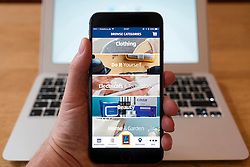 Using iPhone smartphone to display Aldi  discount retailer online store
