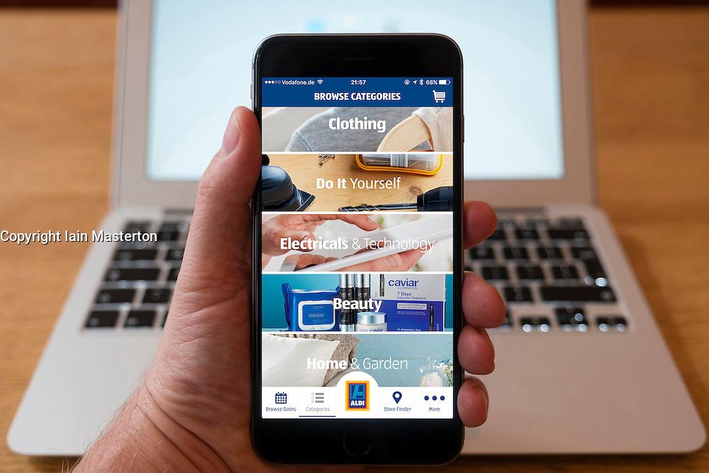 Using iPhone smartphone to display Aldi  discount retailer online store