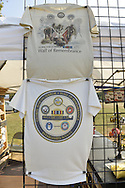 """East Meadow, New York, U.S. 11th September 2013. T-shirts for sale are on disaply at the booth by the Global War on Terror """"Wall of Remembrance"""" a traveling memorial on display in New York for the first time, at Eisenhower Park on the 12th Anniversary of the terrorist attacks of 9/11. The unique 94 feet long by 6 feet high wall has, on one side, almost 11,000 names of those lost on September 11, 2001, along with heroes and veterans who lost their lives defending freedom of Americans over past 30 years. On the wall's other side is a timeline, with photos, covering 1983 to present day."""