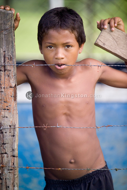A portrait of a young boy in the remote, indigenous Miskito village, Krin Krin, Nicaragua, on the Rio Coco. This town continues to struggle with starvation and death from preventable diseases, worsened by the recent years of crop failure. There is no access to clean water and no healthcare. During the Contra war, residents along this river suffered from violent conflict and harsh Sandinista relocation programs. Once people were allowed to return, the area was devastated by Hurricane Mitch.