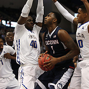 Phillip Nolan, UConn, is defended by D'Andre Wright, and James Woodard, (right), Tulsa, during the UConn Huskies Vs Tulsa Semi Final game at the American Athletic Conference Men's College Basketball Championships 2015 at the XL Center, Hartford, Connecticut, USA. 14th March 2015. Photo Tim Clayton