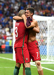 Cristiano Ronaldo of Portugal embraces Pepe of Portugal as Portugal celebrate Winning the Uefa European Championship   - Mandatory by-line: Joe Meredith/JMP - 10/07/2016 - FOOTBALL - Stade de France - Saint-Denis, France - Portugal v France - UEFA European Championship Final