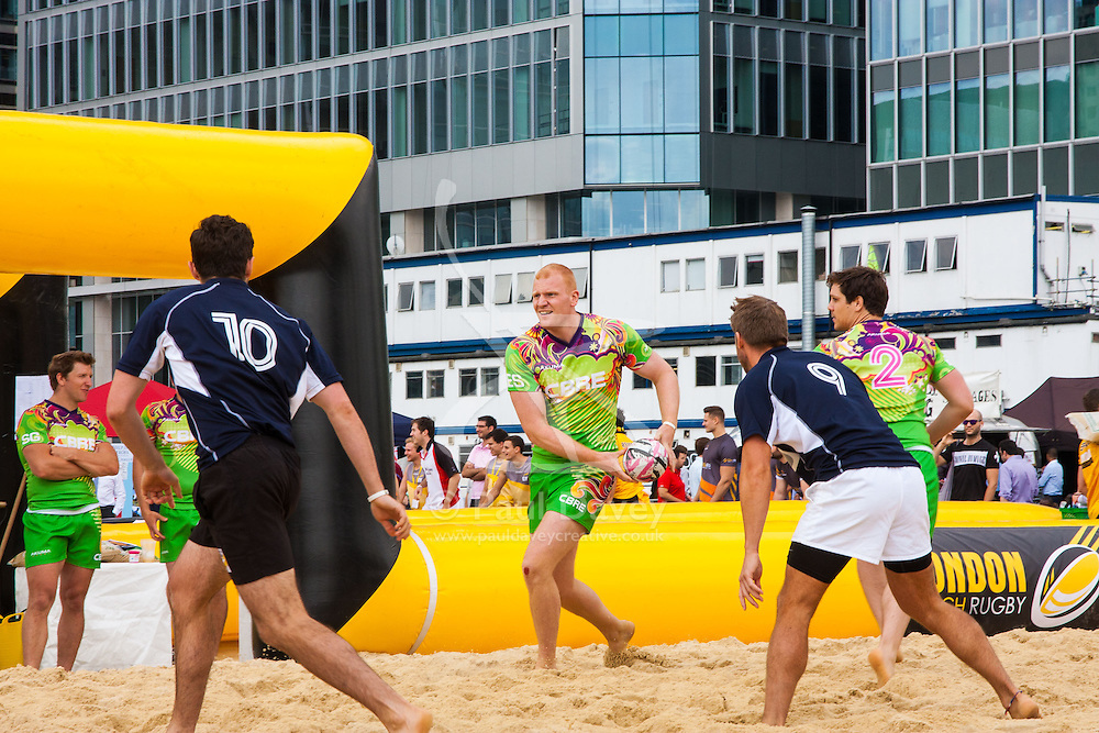 Canary Wharf, London, August 1st 2014. Teams from various London companies compete for glory in the London Beach Rugby tournament