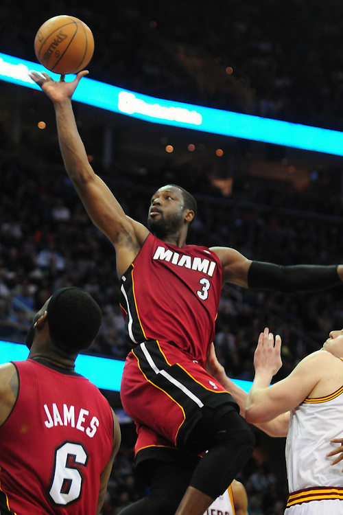 March 29, 2010; Cleveland, OH, USA; Miami Heat shooting guard Dwyane Wade (3) drives to the basket against the Cleveland Cavaliers during the fourth quarter at Quicken Loans Arena. The Cavaliers beat the Heat 102-90. Mandatory Credit: Jason Miller-US PRESSWIRE