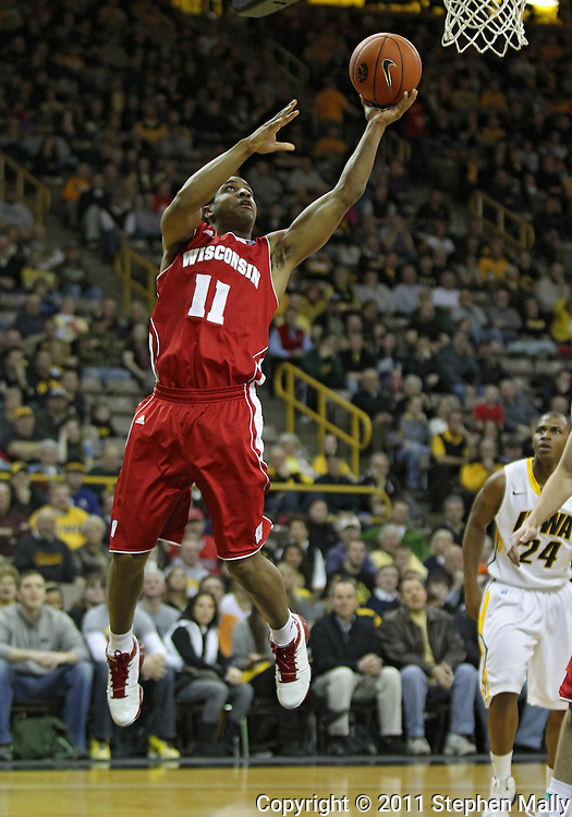 February 09 2011: Wisconsin Badgers guard Jordan Taylor (11) puts up a shot during the first half of an NCAA college basketball game at Carver-Hawkeye Arena in Iowa City, Iowa on February 9, 2011. Wisconsin defeated Iowa 62-59.