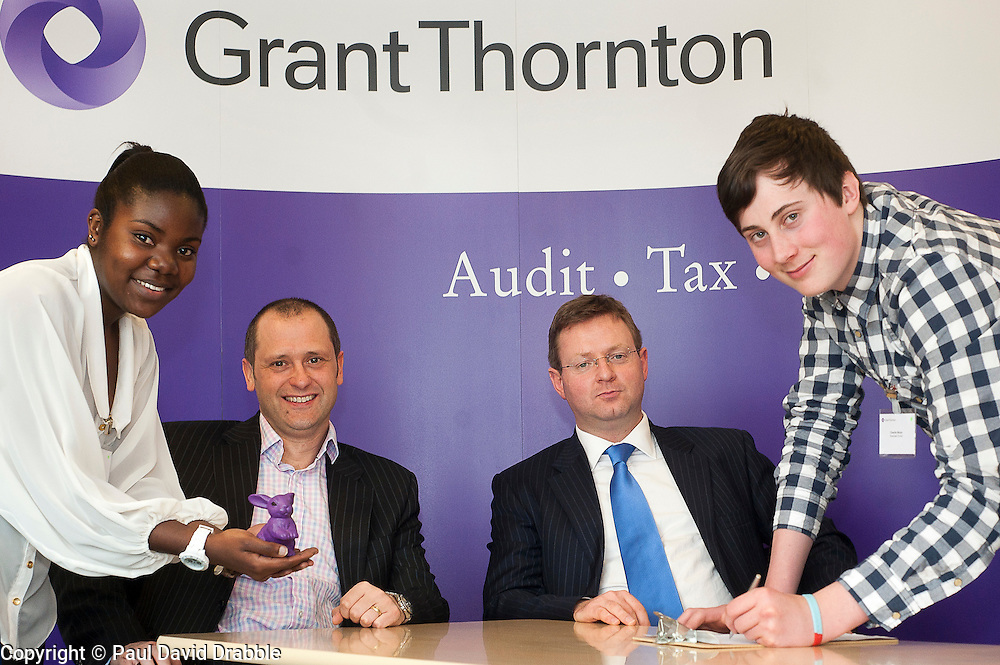 "Grant Thornton Business Awareness Day Chikumo Fiseko of Longley Park 6th form College (right) and James Boreman of Silverdale School (right) make their pitch to The Grant Thornton ""Dragons"" Jamie Preston senior Tax Manager (seated left) and Paul Houghton Partner (seated right)..http://www.pauldaviddrabble.co.uk.4 April 2012 .Image © Paul David Drabble"