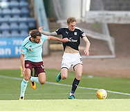 30th September 2017, Dens Park, Dundee, Scotland; Scottish Premier League football, Dundee versus Hearts; Dundee's Kevin Holt battles for the ball with Hearts' Connor Randall