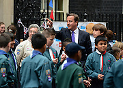 © Licensed to London News Pictures. 03/06/2012. London, UK. The UK Prime Minister hosts a street party on Downing Street today. The party was moved inside number 10 due to the weather but the PM came onto the street to play games with the children who had gathered.  The Royal Jubilee celebrations. Great Britain is celebrating the 60th  anniversary of the countries Monarch HRH Queen Elizabeth II accession to the throne this weekend Photo credit : Stephen Simpson/LNP
