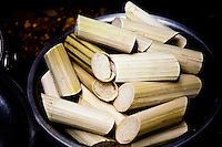 A bowl of bamboo stuffed with sticky rice.