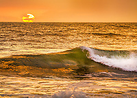 Picture of a golden sunrise at a Outer Banks beach.