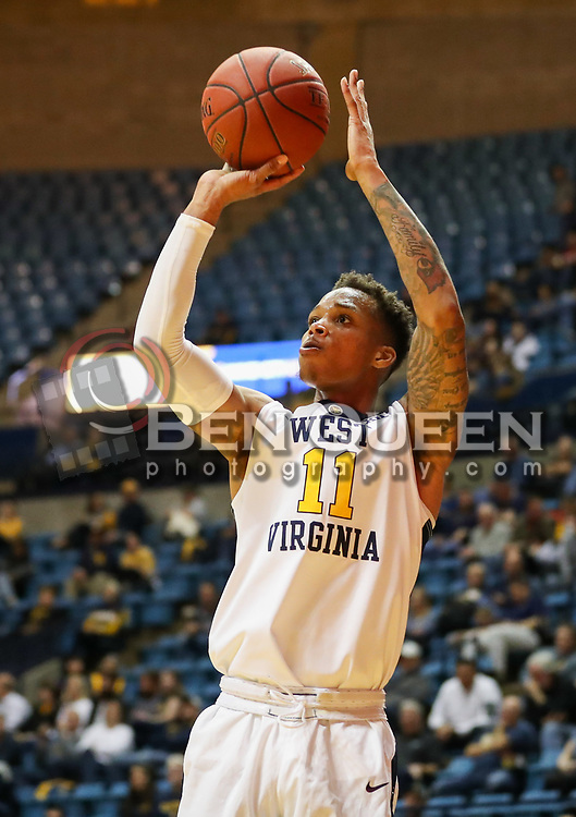 Dec 20, 2017; Morgantown, WV, USA; West Virginia Mountaineers forward D'Angelo Hunter (11) shoots a three pointer during the second half against the Coppin State Eagles at WVU Coliseum. Mandatory Credit: Ben Queen-USA TODAY Sports