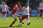 Swindon Keshi Anderson (30) battles for the ball against Accrington Stanley  Erico Sousa (17)during the EFL Sky Bet League 2 match between Swindon Town and Accrington Stanley at the County Ground, Swindon, England on 5 May 2018. Picture by Gary Learmonth.